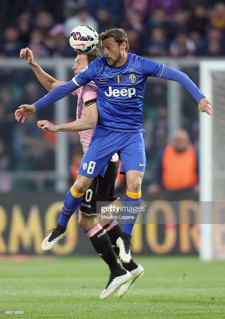 Franco Vazquez (R) of Palermo competes for the ball in air with Claudio Marchisio of Juventus during the Serie A match between US Citta di Palermo and Juventus FC at Stadio Renzo Barbera on March 14, 2015 in Palermo, Italy.