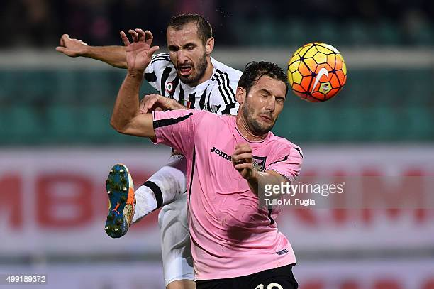 Franco Vazquez of Palermo is challenged by Giorgio Chiellini of Juventus during the Serie A match between US Citta di Palermo and Juventus FC at...