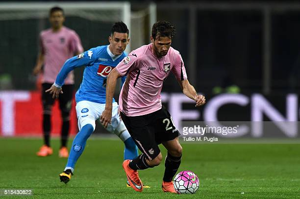 Franco Vazquez of Palermo is challenged by Jose Callejon of Napoli during the Serie A match between US Citta di Palermo and SSC Napoli at Stadio...