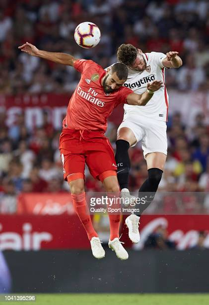 Franco Vazquez of Sevilla competes for the ball with Karim Benzema of Real Madrid during the La Liga match between Sevilla FC and Real Madrid CF at...