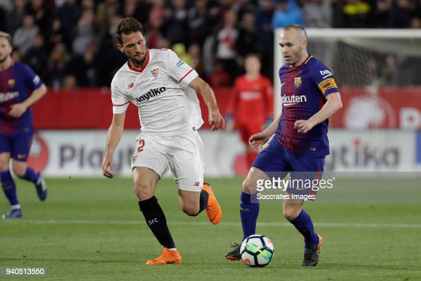 Franco Vazquez of Sevilla FC Andries Iniesta of FC Barcelona during the La Liga Santander match between Sevilla v FC Barcelona at the Estadio Ramon...