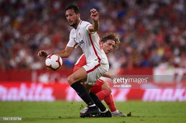 Franco Vazquez of Sevilla FC being followed by Luka Modric of Real Madrid CF during the La Liga match between Sevilla FC and Real Madrid CF at...