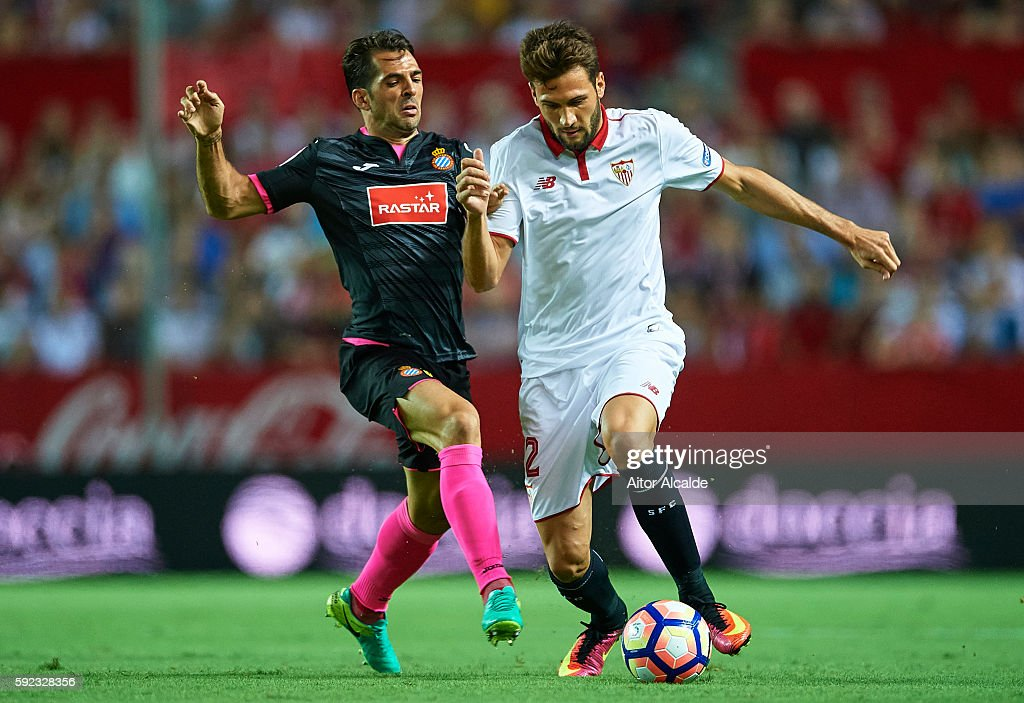 Franco Vazquez of Sevilla FC (R) being followed by Victor Sanchez of RCD Espanyol (L) during the match between Sevilla FC vs RCD Espanyol as part of La Liga at Estadio Ramon Sanchez Pizjuan on August 20, 2016 in Seville, Spain.
