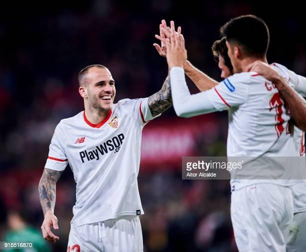 Franco Vazquez of Sevilla FC celebrates with his teammates Joaquin Correa and Sandro Ramirez of Sevilla FC after scoring his team's second goal...