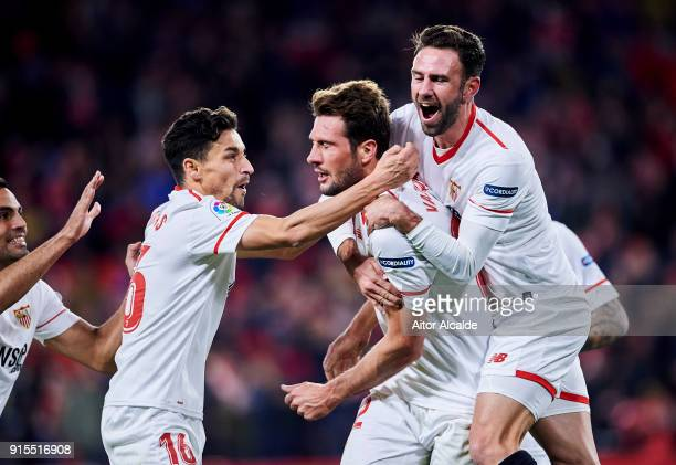 Franco Vazquez of Sevilla FC celebrates with his teammates Miguel Layun and Jesus Navas of Sevilla FC after scoring his team's second goal during the...