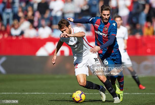 Franco Vazquez of Sevilla FC competes for the ball with Jose Campaña of Levante UD during the La Liga match between Sevilla FC and Levante UD at...