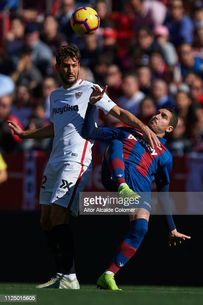 Franco Vazquez of Sevilla FC competes for the ball with Jose Campana of Levante UD during the La Liga match between Sevilla FC and Levante UD at...