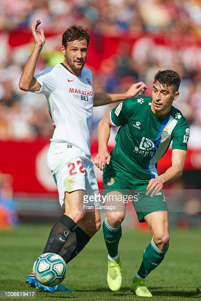 Franco Vazquez of Sevilla FC competes for the ball with Marc Roca of RCD Espanyol during the Liga match between Sevilla FC and RCD Espanyol at...
