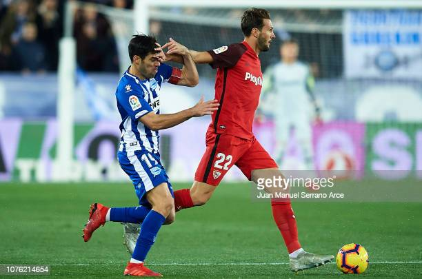Franco Vazquez of Sevilla FC duels for the ball with Manuel Garcia of Deportivo Alaves during the La Liga match between Deportivo Alaves and Sevilla...