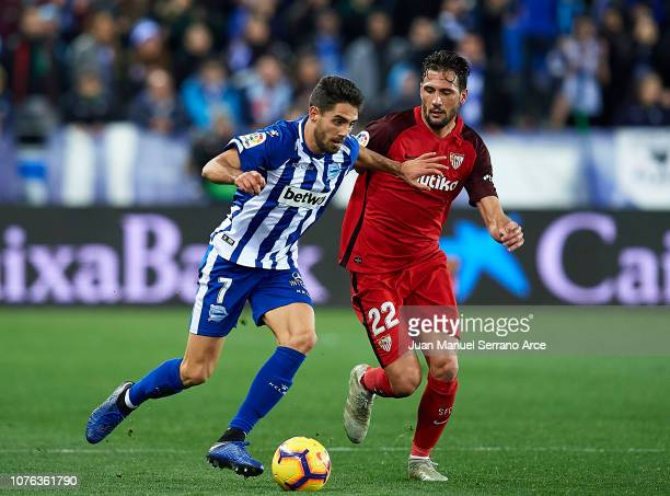 Franco Vazquez of Sevilla FC duels for the ball with Ruben Sobrino of Deportivo Alaves during the La Liga match between Deportivo Alaves and Sevilla...