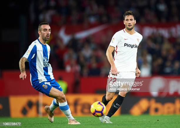 Franco Vazquez of Sevilla FC duels for the ball with Sergi Darder of RCD Espanyol during the La Liga match between Sevilla FC and RCD Espanyol at...