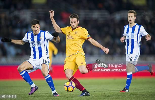 Franco Vazquez of Sevilla FC duels for the ball with Yuri Berchiche of Real Sociedad during the La Liga match between Real Sociedad de Futbol and...
