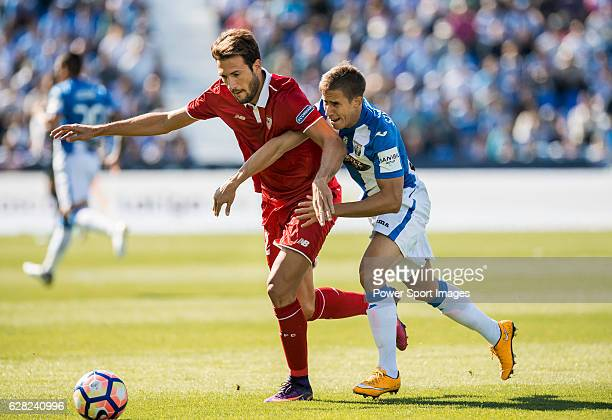 Franco Vazquez of Sevilla FC fights for the ball with Alexander Szymanowski of Deportivo Leganes during their La Liga match between Deportivo Leganes...