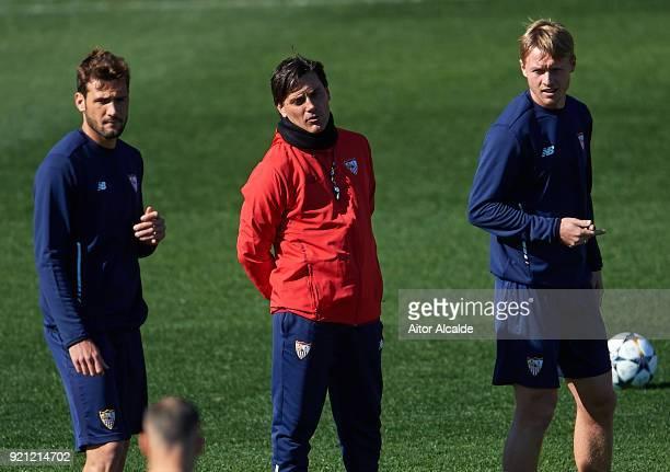 Franco Vazquez of Sevilla FC head coach of Sevilla FC Vincenzo Montella Simon Kjaer of Sevilla FC looks on during a Sevilla FC training session prior...