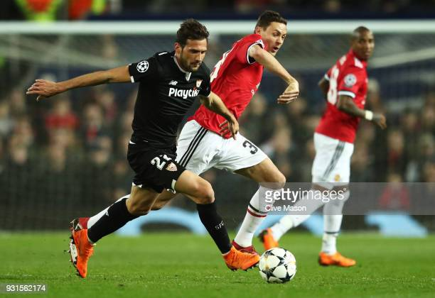Franco Vazquez of Sevilla holds off Nemanja Matic of Manchester United during the UEFA Champions League Round of 16 Second Leg match between...