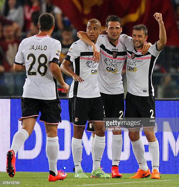 Franco Vazquez with his teammates of US Citta' di Palermo celebrates after scoring the opening goal from penalty spot during the Serie A match...
