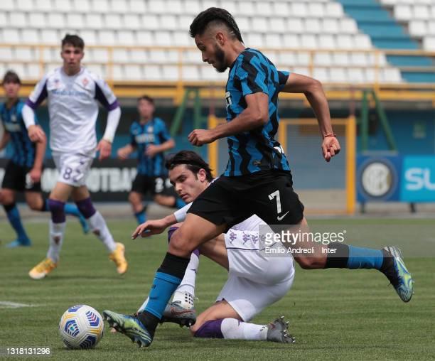 Franco Vezzoni of FC Internazionale U19 is challenged by Eduard Dutu of ACF Fiorentina U19during the Primavera 1 TIM match between FC Internazionale...