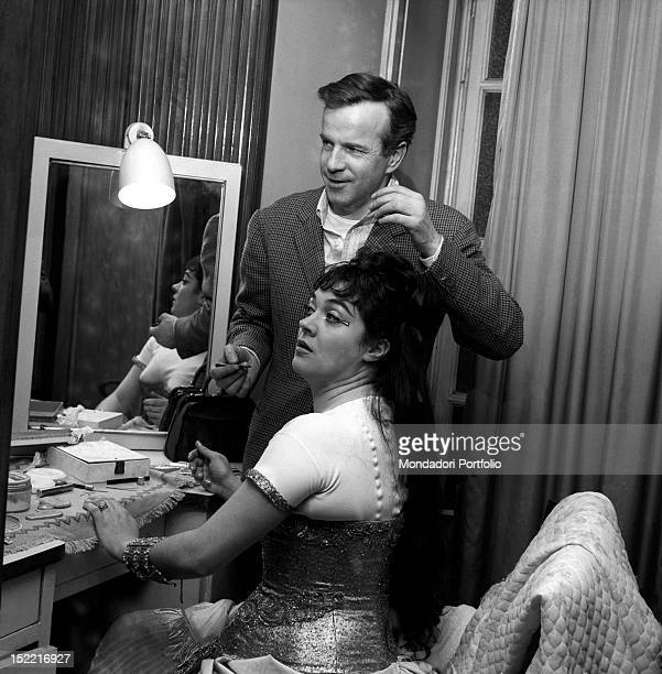 Franco Zeffirelli shows at the mirror the makeup to Fiorenza Cossotto before the rehearsal at the La Scala of the 'Aida' by Giuseppe Verdi Milan...
