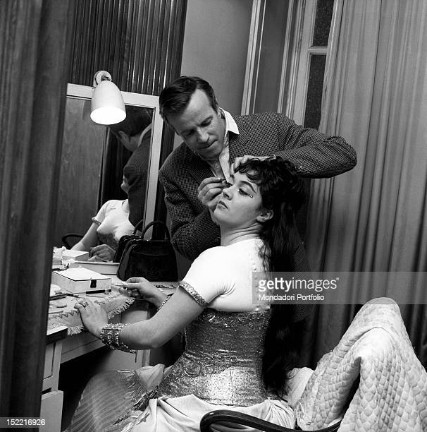 Franco Zeffirelli takes care of Fiorenza Cossotto's make up in the dressing room Milan April 1963