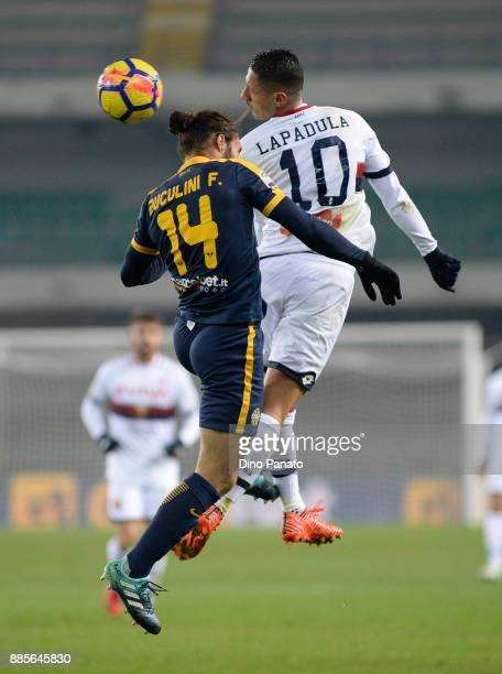 Franco Zuculini of Hellas Verona competes with Gianluca Lapadula of Genoa CFC during the Serie A match between Hellas Verona FC and Genoa CFC at...