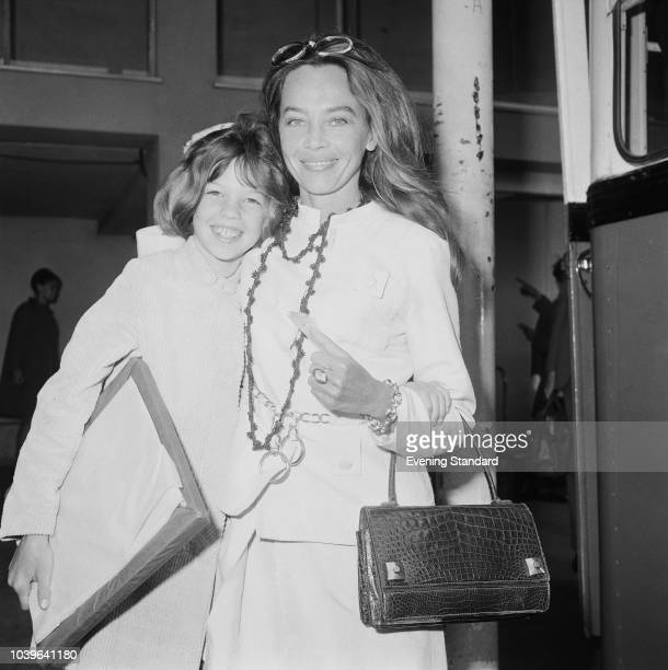 Franco-American actress and dancer Leslie Caron with her daughter Jennifer Caron Hall at Heathrow Airport, London, UK, 3rd July 1968.