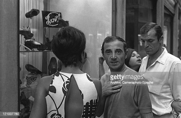 Francoarmenian singer Charles Aznavour portrayed while windowshopping with his daughter Patricia called Seda his partner Lakoua Eddie Kazo and Dany...