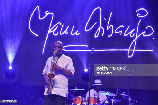 FrancoCameroonian saxophonist and world jazz singer Emmanuel N'Djoke Dibango known as Manu Dibango performs on June 29 2018 during a concert at the...