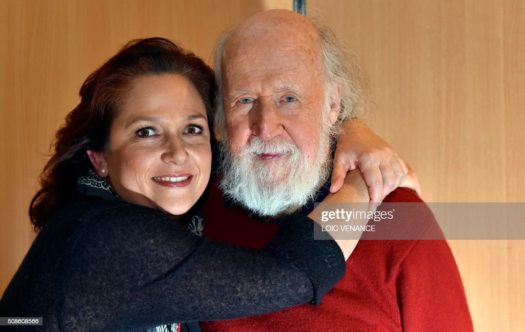 Franco-Canadian Astrophysicist Hubert Reeves poses with Artistic Director and violinist Karine Lethiec prior to performing 'Cosmophonies' with Ensemble Calliopee during the 'Folle Journee de Nantes' classical music festival in Nantes, western France, on February 5, 2016. / AFP / LOIC