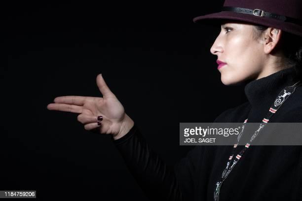 TOPSHOT FrancoChilean rapper Ana Tijoux also kown as Ana Maria Merino Tijoux poses during a photo session in Paris on November 26 2019