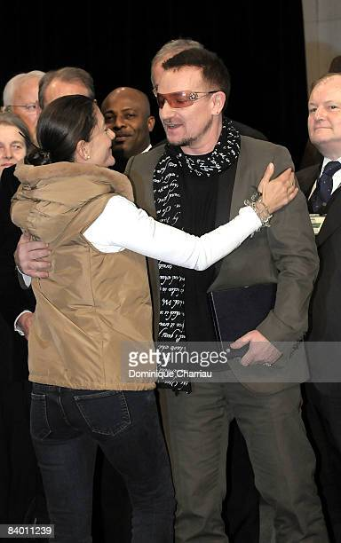 FrancoColombian politician and former FARC hostage Ingrid Betancourt greets Laureate of the peace summit Award 2008 lead Singer of U2 Bono during the...