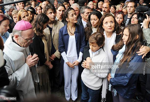 FrancoColombian politician and former hostage Ingrid Betancourt with her family at the Massabielle cave on July 12 in Lourdes southwestern France...