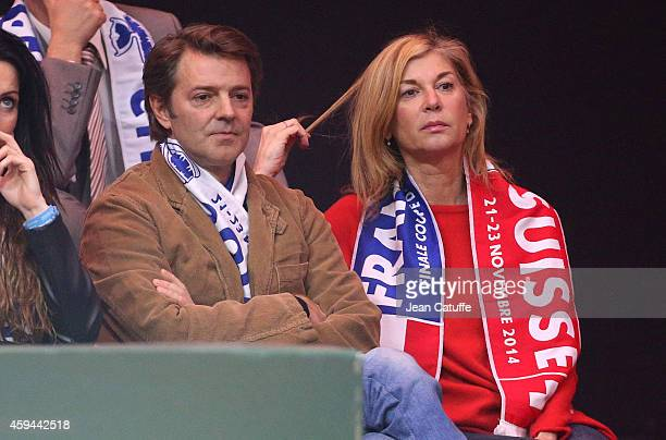 Francois Baroin and his girlfriend Michele Laroque attend day two of the Davis Cup tennis final between France and Switzerland at the Grand Stade...