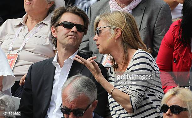 Francois Baroin and Michele Laroque attend day 2 of the French Open 2015 at Roland Garros stadium on May 25, 2015 in Paris, France.