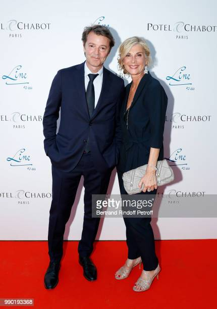 Francois Baroin and Michele Laroque attend Line Renaud's 90th Anniversary on July 2, 2018 in Paris, France.