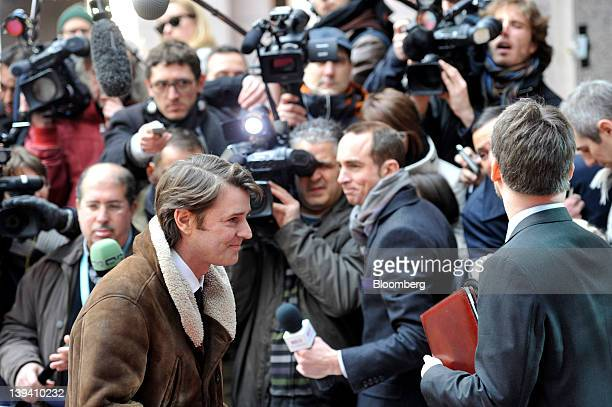 Francois Baroin, France's finance minister, left, passes members of the media as he arrives to attend the Eurogroup finance ministers meeting at the...