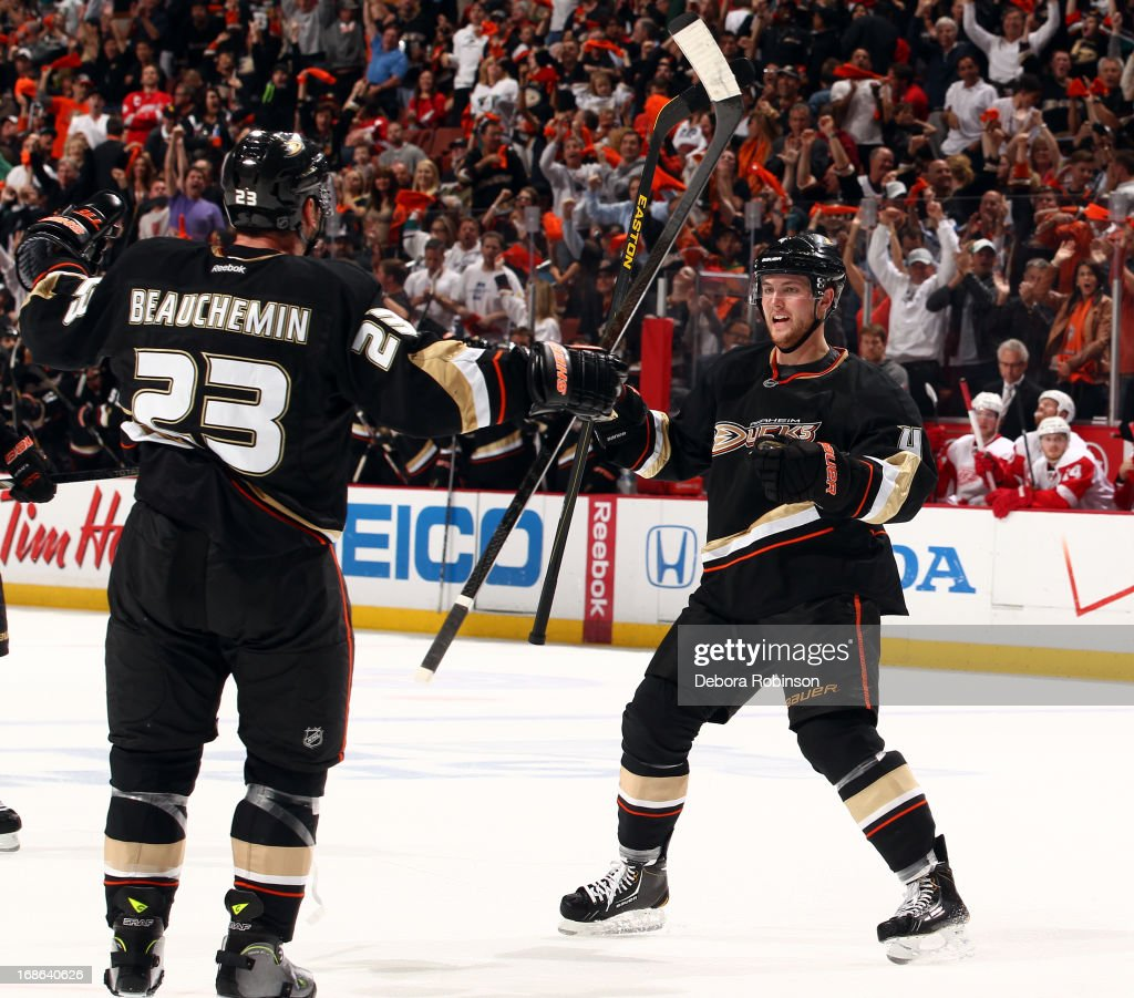 Francois Beauchemin #23 and Cam Fowler #4 of the Anaheim Ducks celebrate a goal scored against the Detroit Red Wings in Game Seven of the Western Conference Quarterfinals during the 2013 NHL Stanley Cup Playoffs at Honda Center on May 12, 2013 in Anaheim, California.