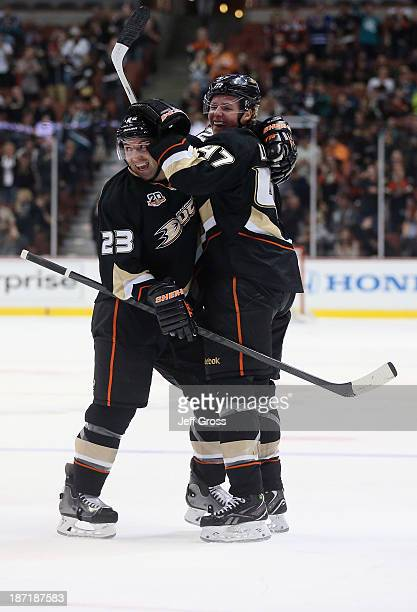 Francois Beauchemin and Hampus Lindholm of the Anaheim Ducks celebrate Lindholm's first NHL goal in the first period against the Phoenix Coyotes at...