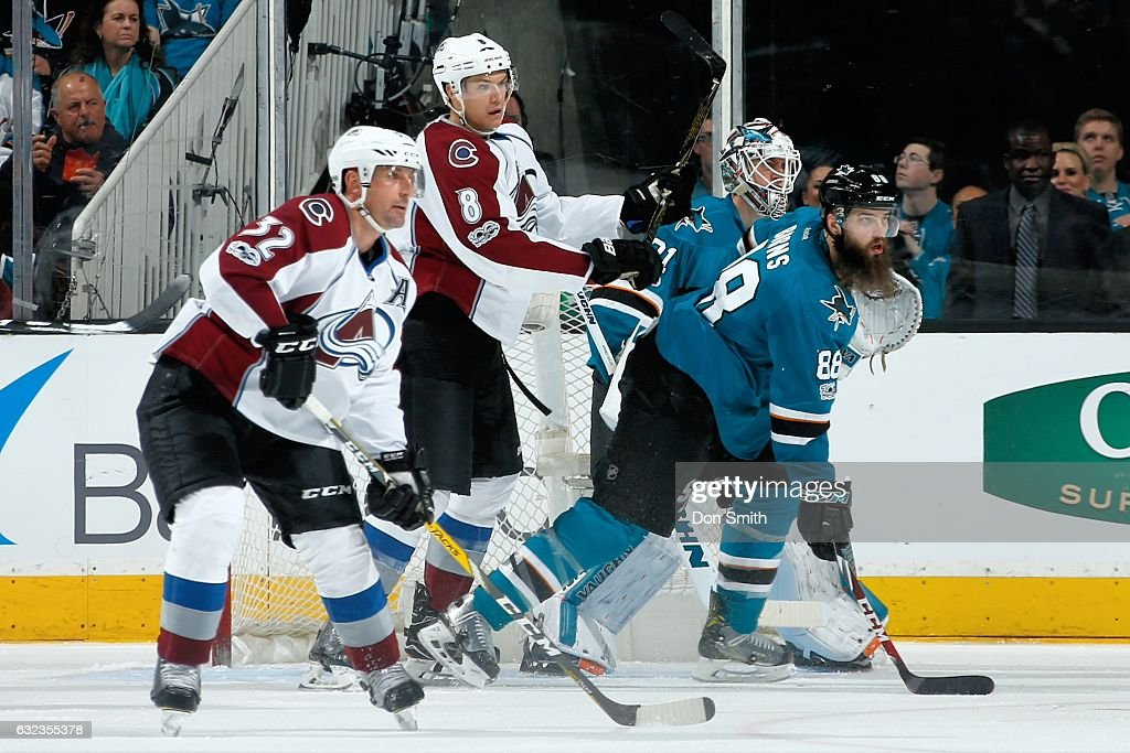 Francois Beauchemin #32 and Joe Colborne #8 of the Colorado Avalanche along with Martin Jones #31 and Brent Burns #88 of the San Jose Sharks look during a NHL game at SAP Center at San Jose on January 21, 2017 in San Jose, California.