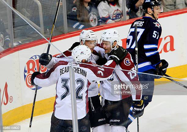 Francois Beauchemin Carl Soderberg and Mikhail Grigorenko of the Colorado Avalanche celebrate a second period goal against the Winnipeg Jets at the...