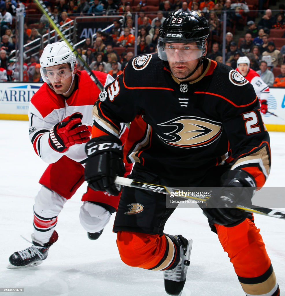Francois Beauchemin #23 of the Anaheim Ducks battles for position against Derek Ryan #7 of the Carolina Hurricanes during the game on December 11, 2017 at Honda Center in Anaheim, California.