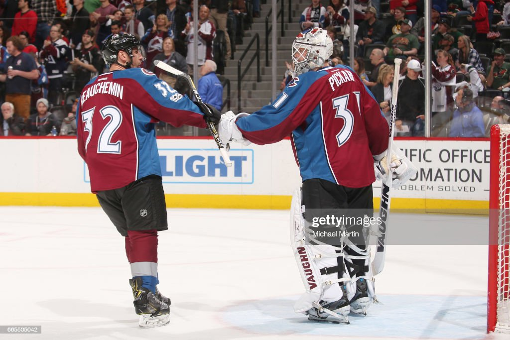 Francois Beauchemin #32 of the Colorado Avalanche bumps gloves with teammate, goaltender Calvin Pickard #31 after a goal against the Minnesota Wild at the Pepsi Center on April 6, 2017 in Denver, Colorado. The Wild defeated the Avalanche 4-3.