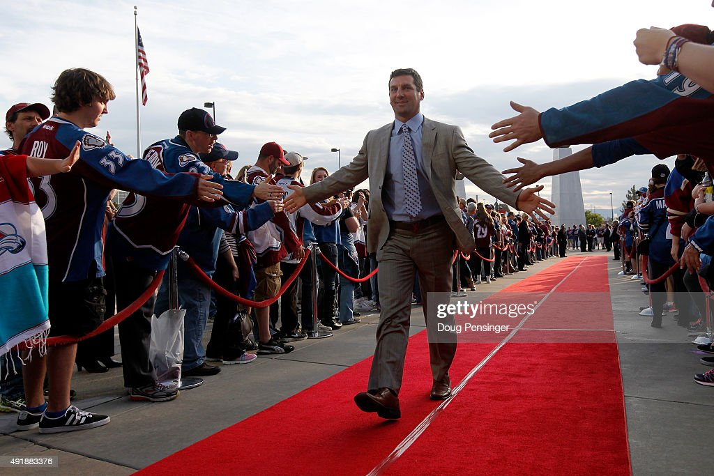 Francois Beauchemin #32 of the Colorado Avalanche is welcomed by fans on the red carpet as he arrives for the home opener against the Minnesota Wild at Pepsi Center on October 8, 2015 in Denver, Colorado.
