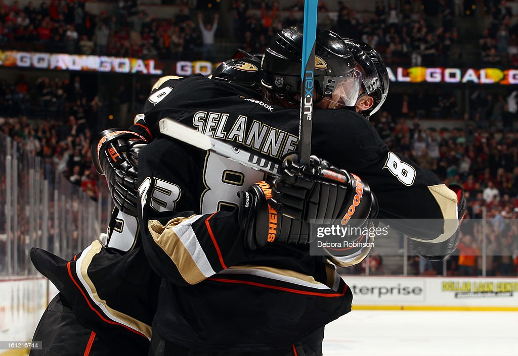 Francois Beauchemin #23, Teemu Selanne #8 and Ryan Getzlaf #15 of the Anaheim Ducks celebrate a goal scored during the game against the Chicago Blackhawks on March 20, 2013 at Honda Center in Anaheim, California.