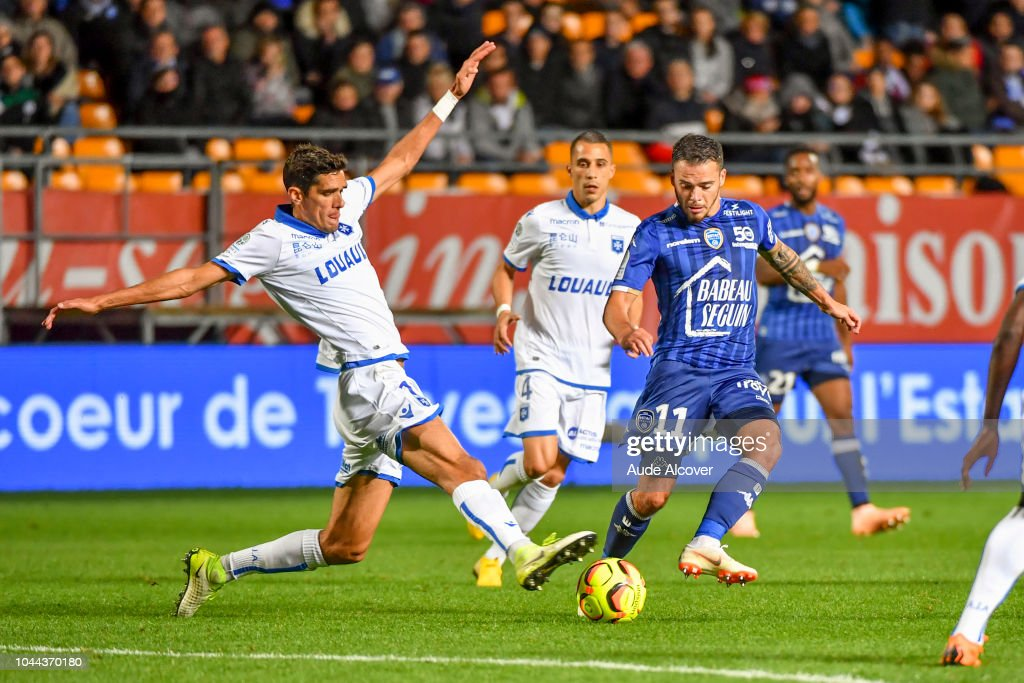 88172c8d8991 Francois Bellugou of Auxerre and Bryan Pele of Troyes during the ...