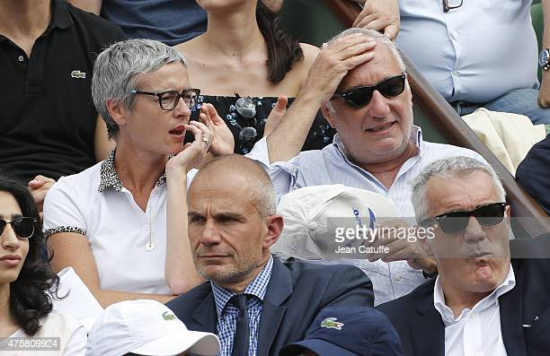 Francois Berleand and his girlfriend Alexia Stresi attend day 10 of the French Open 2015 at Roland Garros stadium on June 2 2015 in Paris France
