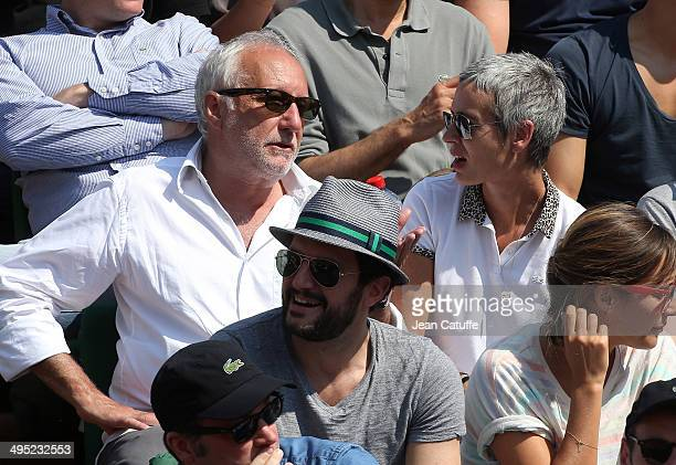 Francois Berleand and his wife Alexia Stresi attend Day 7 of the French Open 2014 held at RolandGarros stadium on May 31 2014 in Paris France