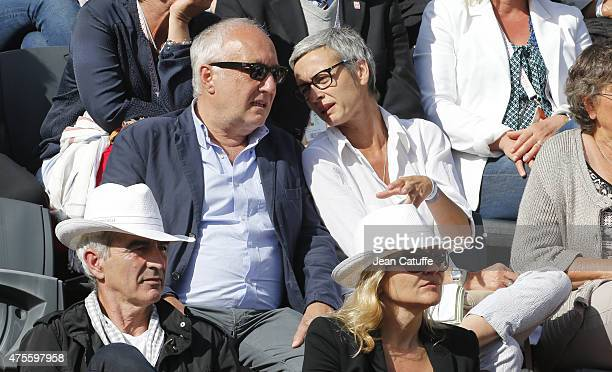 Francois Berleand and his wife Alexia Stresi attend day 9 of the French Open 2015 at Roland Garros stadium on June 1 2015 in Paris France