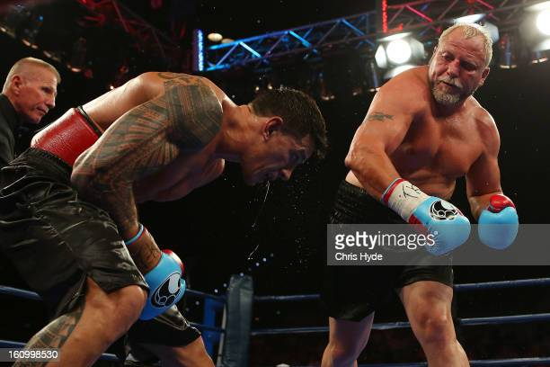 Francois Botha punches Sonny Bill Williams during their heavyweight bout at the Brisbane Entertainment Centre on February 8 2013 in Brisbane Australia