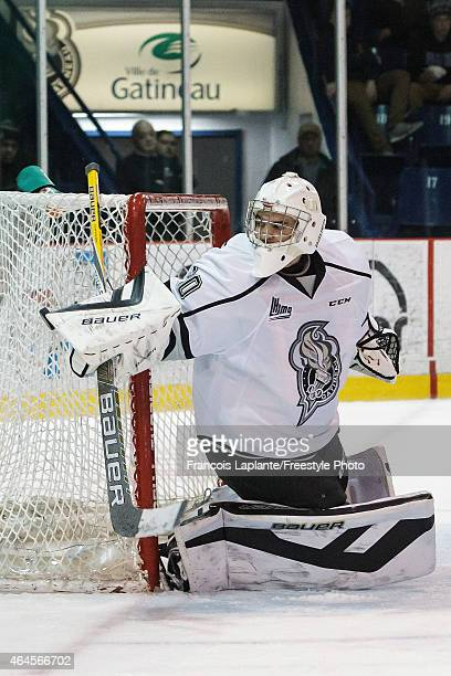 Francois Brassard of the Gatineau Olympiques guards his net against the Chicoutimi Sagueneens during a game on February 20, 2015 at Robert Guertin...