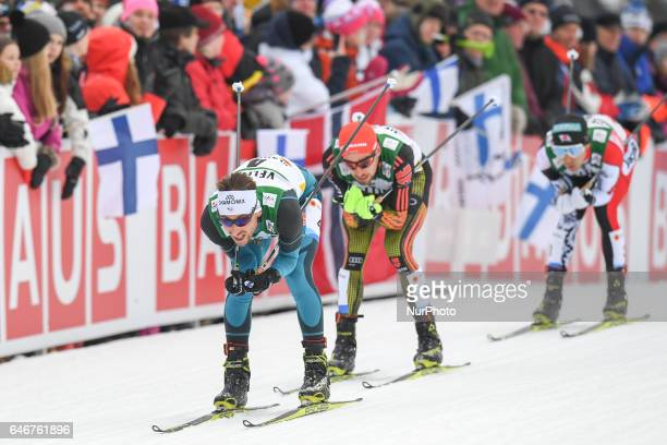 Francois Braud from France in lead, ahead of Johannes Rydzek from Germany, during Men 10km Nordic Combined final, at FIS Nordic World Ski...